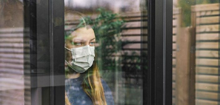 Effects of Economic Uncertainty on Mental Health in the COVID-19 Pandemic Context: Social Identity Disturbance, Job Uncertainty and Psychological Well-Being Model
